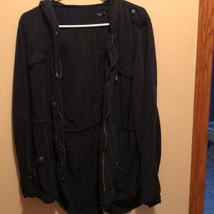 Navy blue jacket with buttons and pockets